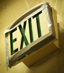 Exit sign at high school, held up with duct tape